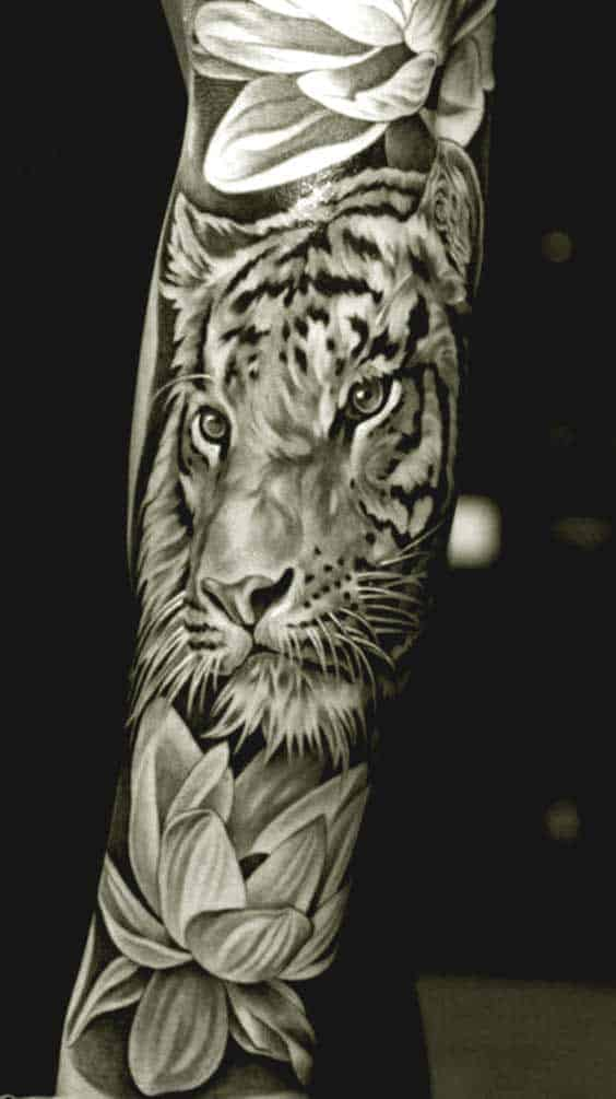 Tiger and lotus flower tattoo on inner arm for men