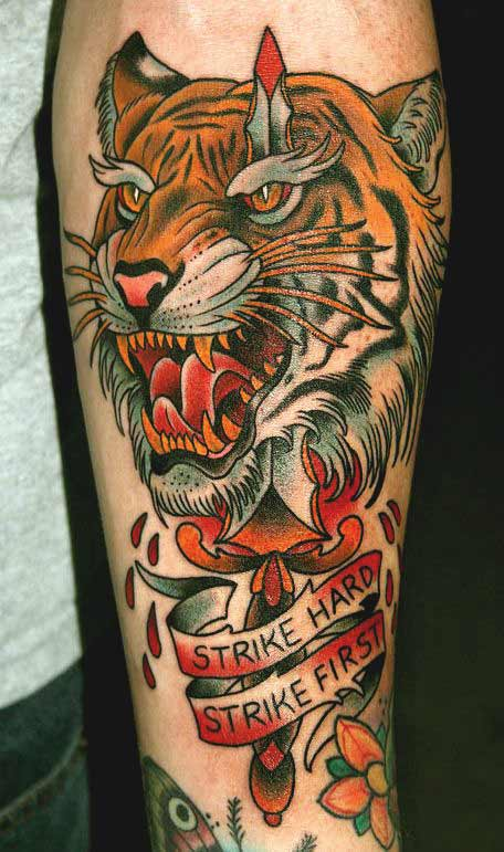 Japanese tiger face tattoo with quote on inner forearm
