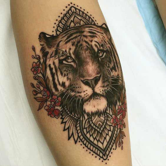 Tiger face with mandala flower tattoo on leg ideas for girls