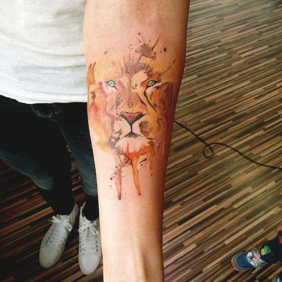 Watercolor lion forearm tattoo