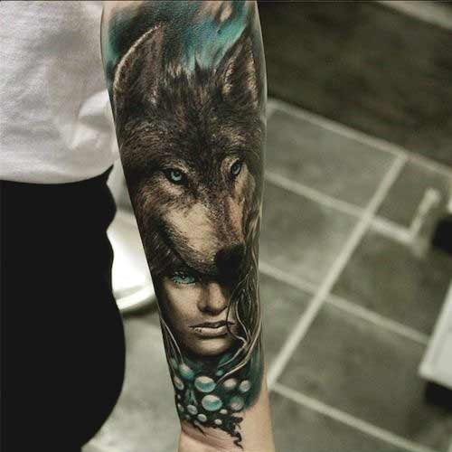 Wolf and girl face tattoo on inner forearm