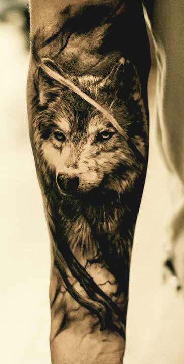 Wolf outer forearm tattoos