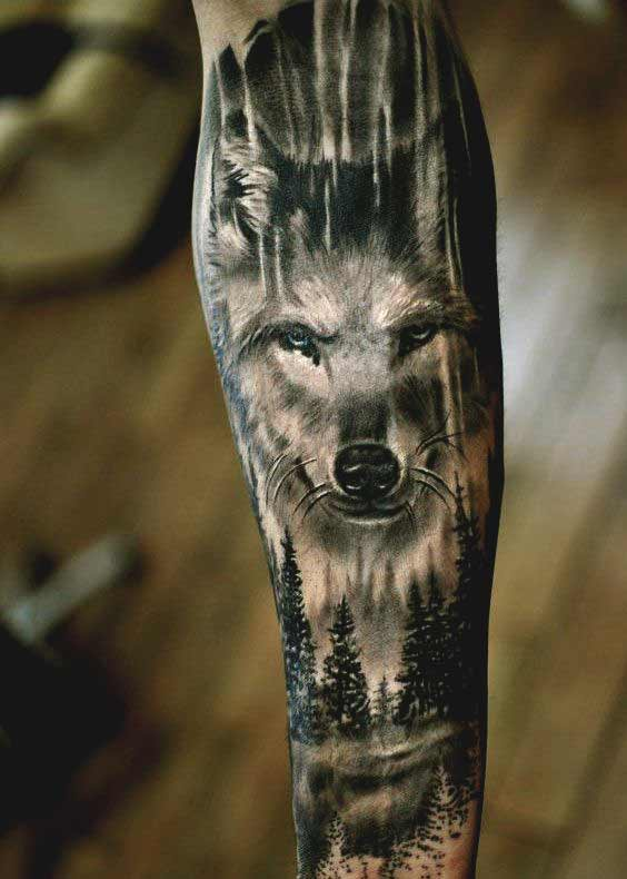Wolf and tree inner forearm tattoos