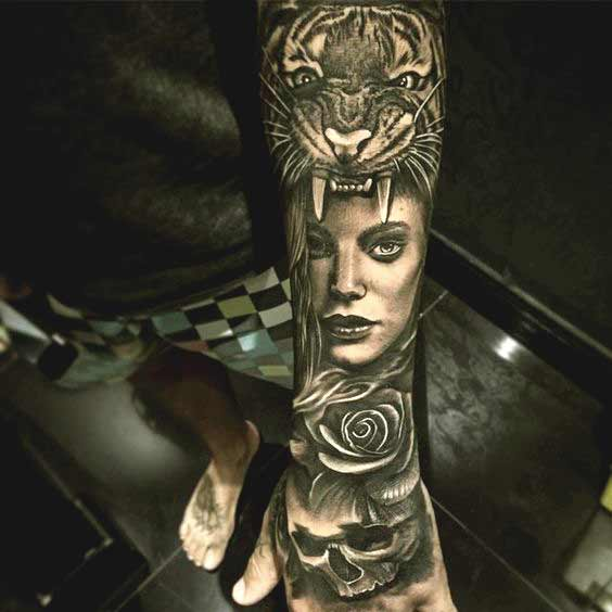 Tiger and girl face tattoo on outer forearm