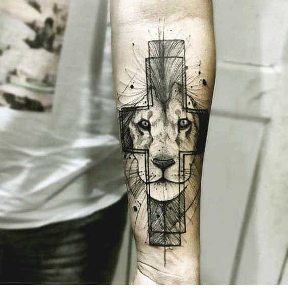 Geometric and cross including lion tattoo