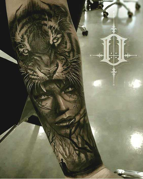 Tiger and face tattoo on inner forearm