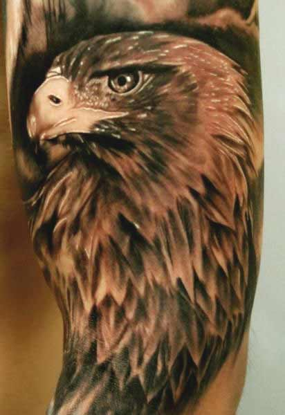 Traditional eagle face tattoos