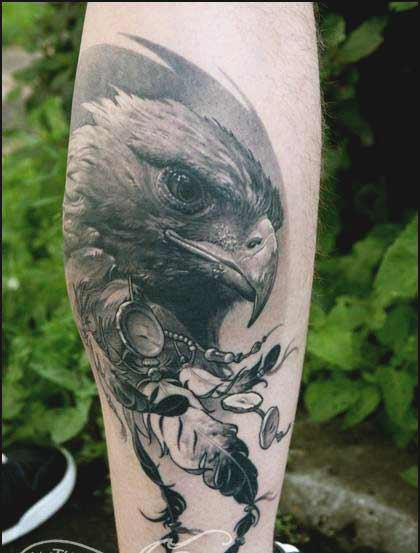 Eagle with feather tattoos designs on forearm ideas