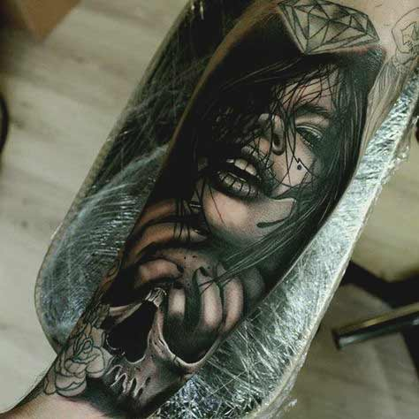 girls face holding skull forearm tattoo